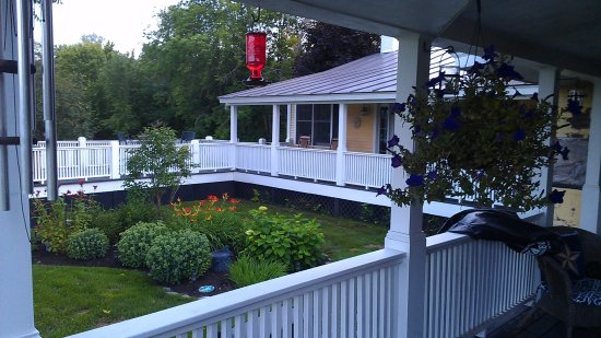 Enjoy distant views from across the Quechee Gorge while relaxing on our back porch
