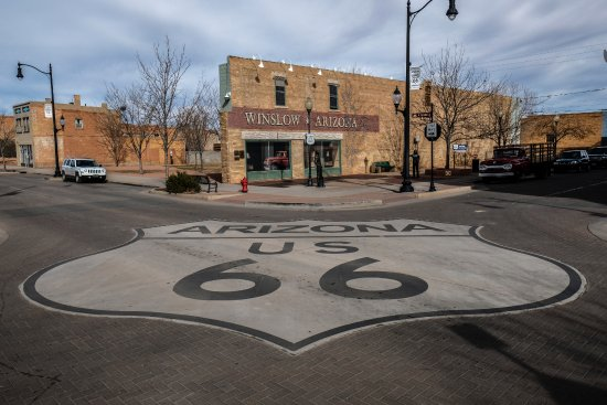 Winslow, AZ: Route 66 sign painted on the street at Standin' on the Corner.