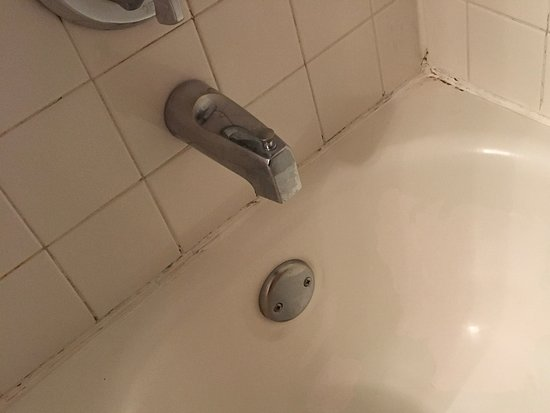 Peeling resurface enamel on tub..not clean - Picture of Hotel ...