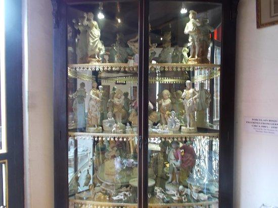 Beautiful porcelain dolls & mini-sculptures on display inside a ...