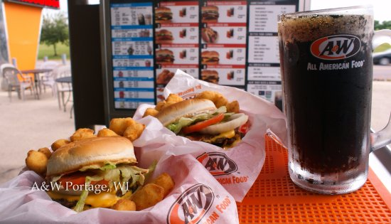 Portage, WI : Retro drive-in experience! Carhops bring your food on a tray to your vehicle.