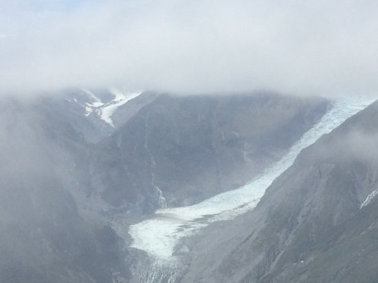 Fox Glacier, New Zealand: The cloud clearing from the glacier, at the top of Mt Fox
