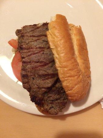Callahan's Restaurant & Deli: 1/2 of the delicious Rib Eye steak sandwich.