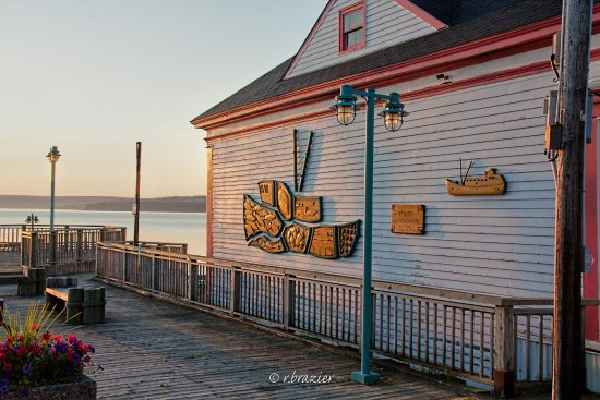 Hand-carved wall mural on Digby waterfront.
