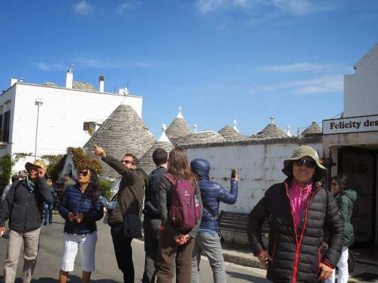 Explaining The Meanings Of The Symbols Painted On The Trulli In