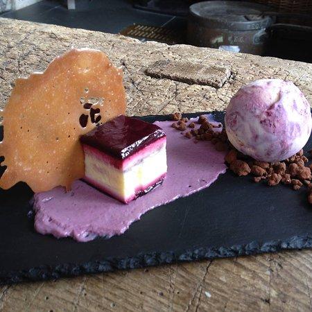 Wigmore, UK: Blackcurrant and white chocolate delice, ripple ice cream, white chocolate tuile