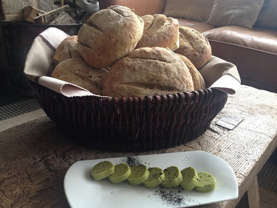 Wigmore, UK: Freshly baked bread, with wild sorrel and confit garlic butter.