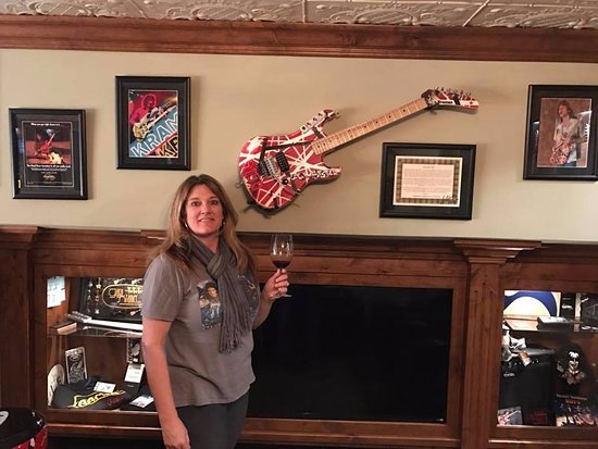 Paso Robles, CA: Lisa enjoying fine wine in front of a master piece.