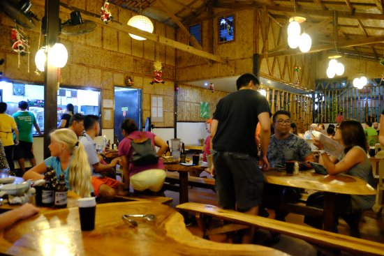 Lolo Nonoy's Food station: Tables and benches made of big logs