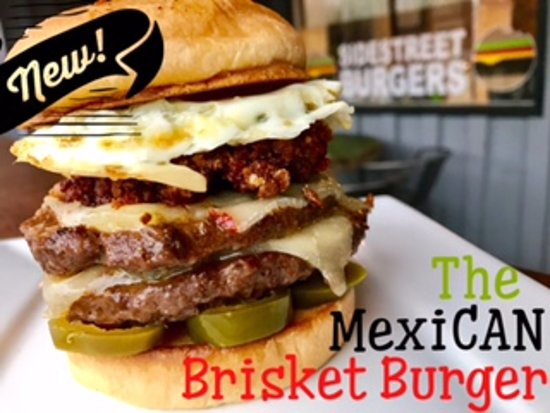 Olive Branch, MS: The MexiCAN Brisket Burger With Choizo, Fried Egg, Pickled Jalapenos, and Pepperjack Cheese