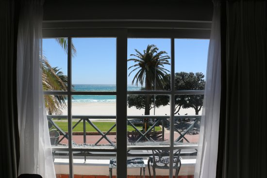 The Place on the Bay: View from the bed room. A small balcony with a table and chairs adds to the charm.