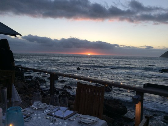 Tintswalo Atlantic: Having a meal watching the sun go down