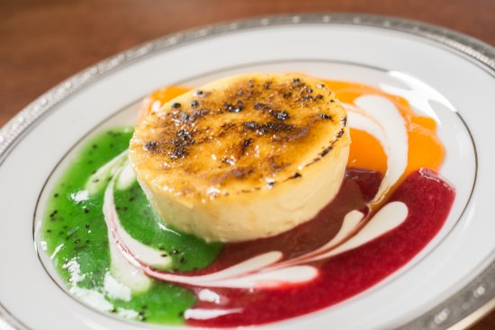 "Darien Center, นิวยอร์ก: Classic French ""Burnt Cream"". Creme Brulee with a fruit sauce medley. Always on our dinner menu."