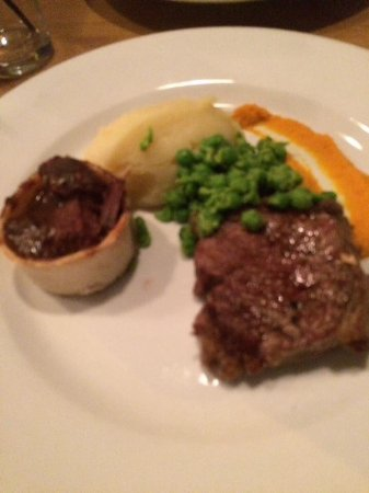 Airdrie, UK: Duo of beef, mini steak pie, roast sirloin, buttery mash and peas
