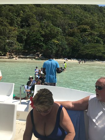 A Paradise Cove Escape and Haitian Village Experience: Walking from boat to beach 😊