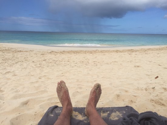 West End Village, Anguilla: Watching a light rain out at sea from the beach at Four Seasons Anguilla