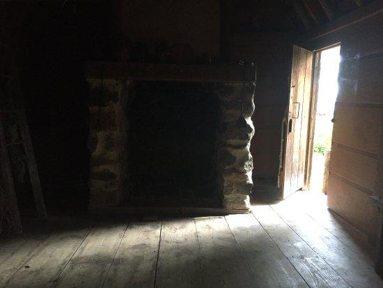 Salem 1630: Pioneer Village: fireplace, Check Bear skin rug... be right back!