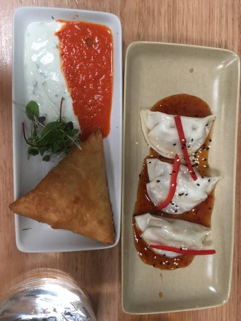 Fitzroy, Australia: Samosa (what's with all the sauce) and Gyoza (weird dressing)
