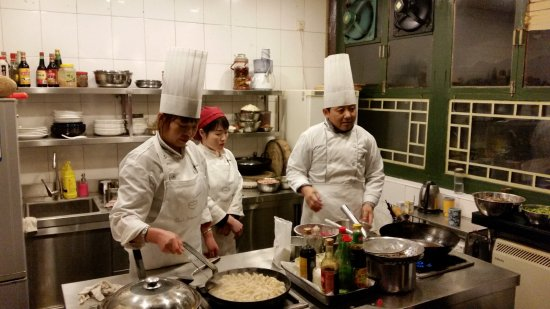 Black Sesame Kitchen : chefs at work making dumplings