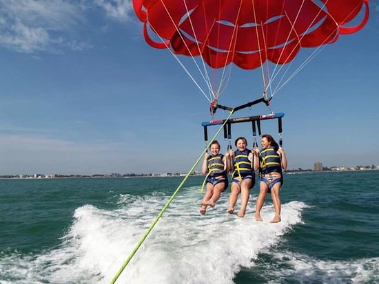 All Island Watersports: Up to 3 can enjoy Parasailing memories high above Ft Myers Beach.