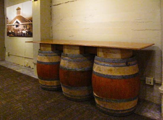 Testarossa Winery - Los Gatos - Tasting room wine barrel table and historic photos