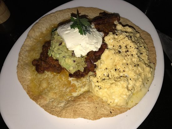 Havelock North, New Zealand: Tried the Huevos Rancheros - Tortilla, scrambled eggs, mildly spiced beans, guacamole and sour c