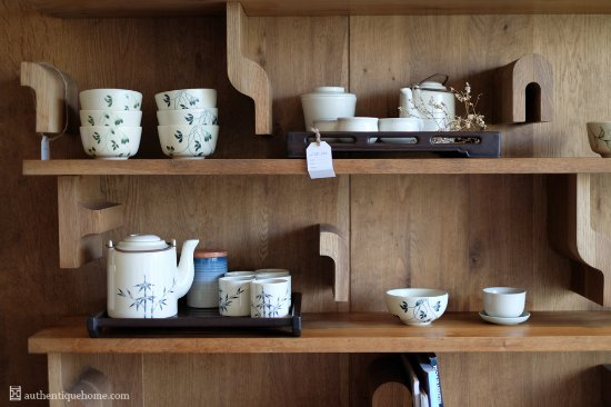 Authentique Home: Ceramics line our beautiful music note bookshelf at our 1st floor showroom