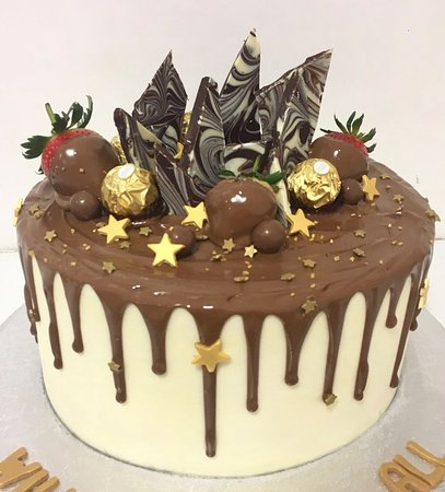 Hey Little Cupcake!: A beautiful sparkling star cake with milk chocolate drizzle. Strawberries & so much more