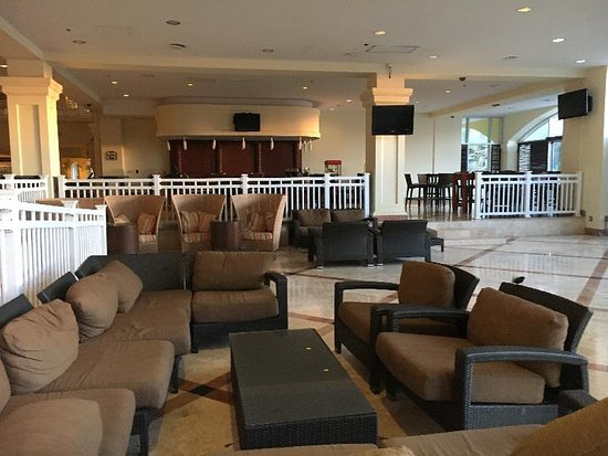 St. Kitts Marriott Resort & The Royal Beach Casino: Lobby seating - bar in background (it was morning)
