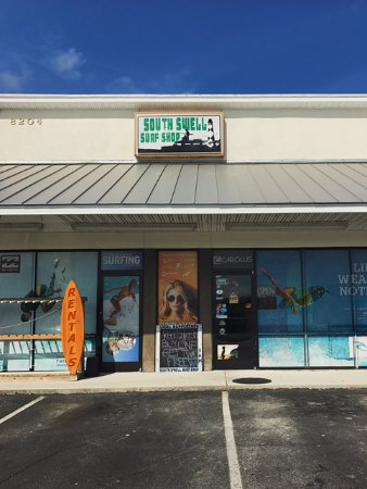 Emerald Isle, NC: South Swell Surf Shop, we have friendly, knowledgable staff ready to cater to your every surf ne