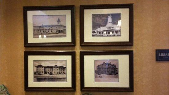 Lighthouse Inn at Aransas Bay: Photos of old hotels in the lobby area.