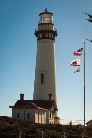 Pescadero, CA: Closeup of the lighthouse itself. It was a very windy day, as you can see from the flags.