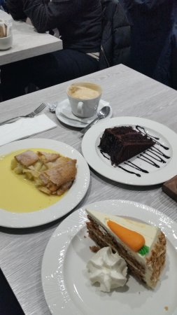 Village Cafe: Carrot cake with squirty cream, apple pie with watery custard, chocolate cake