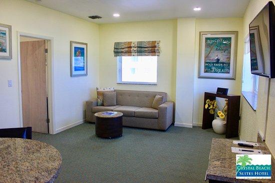 Crystal Beach Suites Oceanfront Hotel Premium King Suite Living Room With Queen Sleeper Sofa