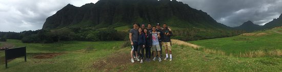 Kaneohe, HI: A panoramic shot of our group with a sample backdrop of what the landscape is like
