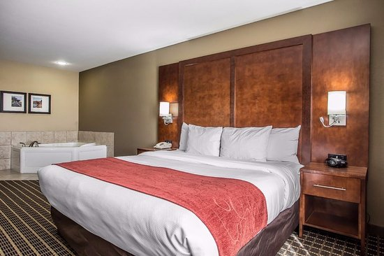Delavan, WI: King Bed with a Whirlpool in the room