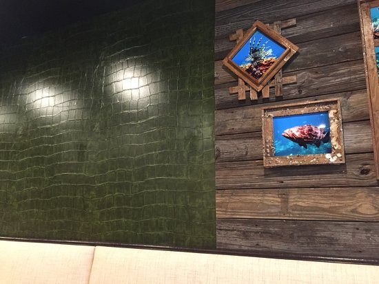 The Feast Restaurant Croc Skin And Driftwood Decor