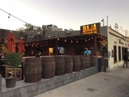 Baja Brewing Company: Patio with a inside bar