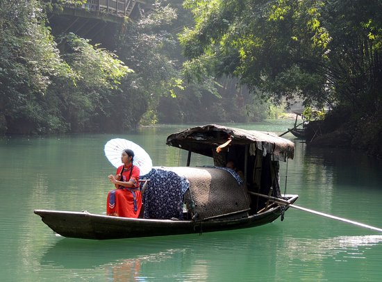 Yichang, China: Costumed girl on a boat in the river tributary