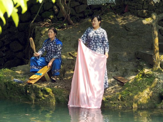 Yichang, China: Chinese women washing cloths on the river tributary