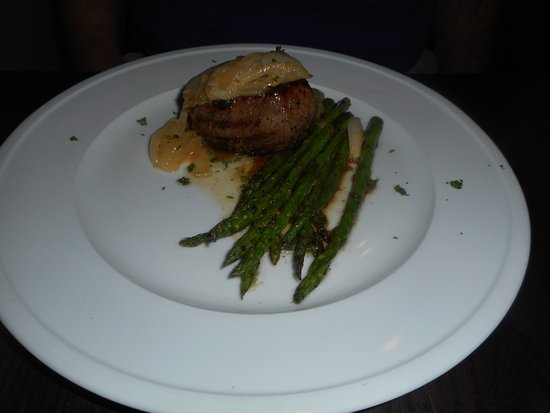 Broussard, LA: My husband's filet was topped with grilled onions.