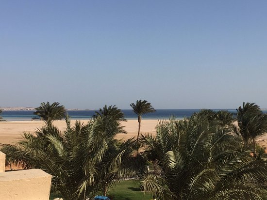 The Makadi Palace Hotel: View from our balcony, the bed,view from friends balcony, one of many pools, view of beach near