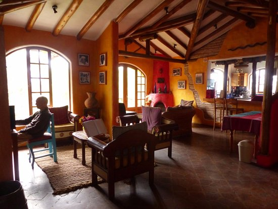 La Casa Sol Otavalo: seating area with log fire in corner