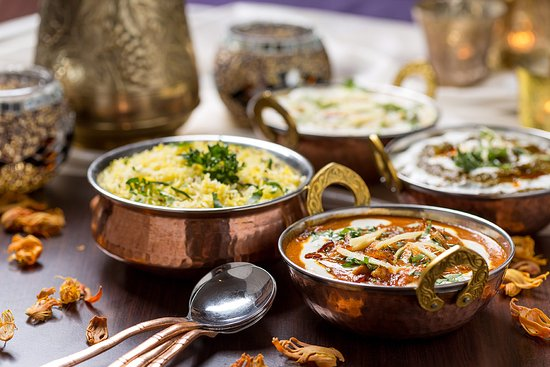 Forest Row, UK : Delicious Chicken korma and Vegetable curry with Pilau rice