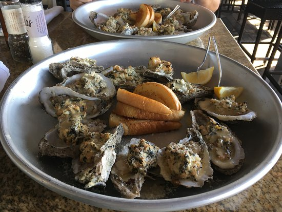 Oysters topped with spinach and lobster