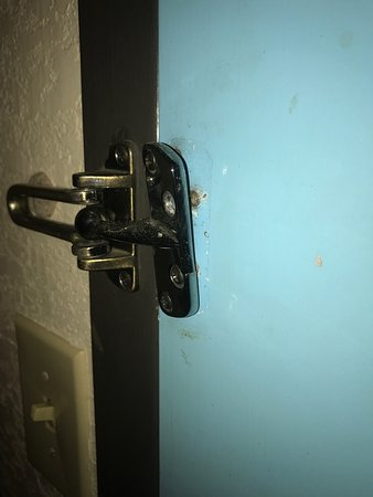 Blythewood, SC: Another room with a broken hinge and doorknob with hinge coming off wall from door being kicked