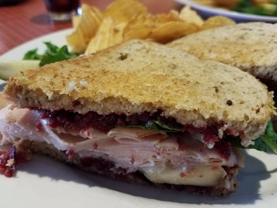 The Painted Fish Cafe : Turkey Brie Sandwich, packed with turkey, cranberry, and spinach. Great flavor, texture, and hug