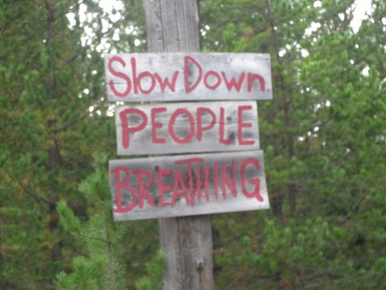 Polebridge, MT: sign outside of town