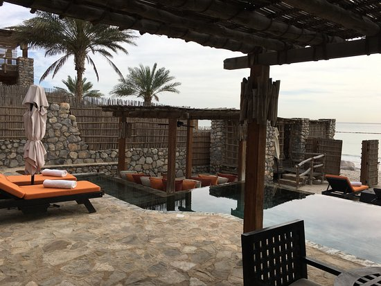 Six Senses Zighy Bay: View across the deck, pool to the beach