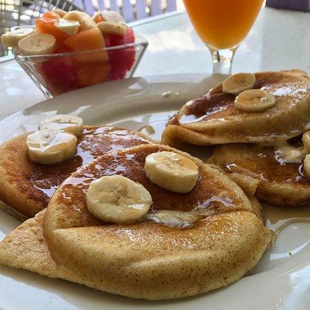 Caribbean Colors Art Cafe : Banana Pancakes, Fresh Fruit, and Orange Juice....everything absolutely Divine!